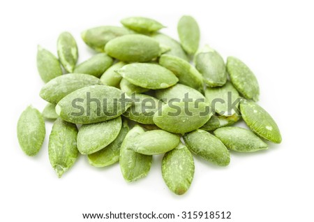 Dried green Pumpkin Seeds on White Background