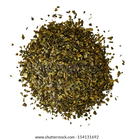 Dried green tea leaves pile from top on white background - stock photo
