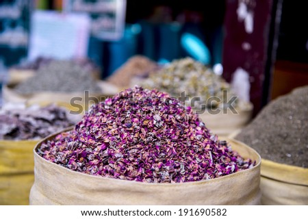 dried herbs flowers spices in Bazaar or souk Khan el-Khalili, and security guard,Cairo, Africa - stock photo