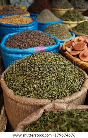 dried herbs flowers spices in the Marrakesh street shop, shallow dof - stock photo