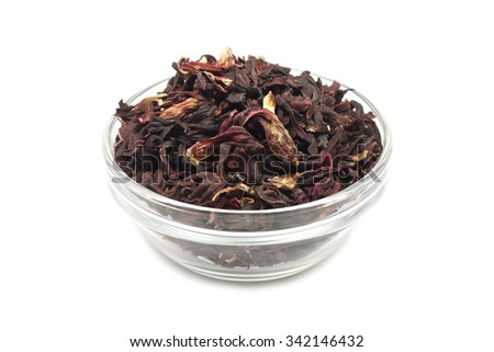 Dried Hibiscus buds in a glass on a white background
