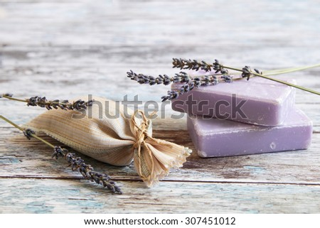 dried lavender and lavender soap  on rustic wooden board