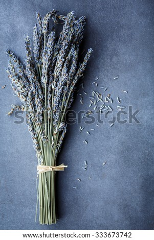 Dried lavender bunch on dark table - stock photo