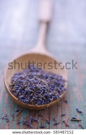 Dried lavender flowers in a bamboo spoon. Selective focus - stock photo