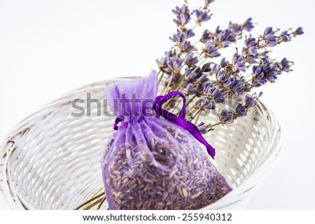Dried Lavender flowers with lavender seeds in a sachet - stock photo