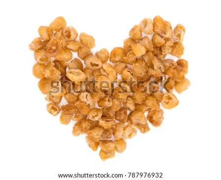 dried longan fruit making a heart shape isolated on white background
