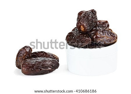 Dried Medjool Dates over a white background with light shadow.