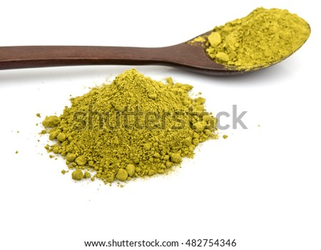 Dried moringa powder in wooden spoon over white background