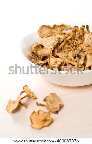 Dried mushrooms of chanterelle or girolle simple food composition - stock photo