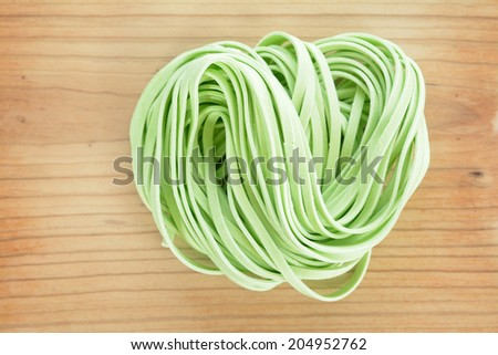 dried noodle on wooden table  - stock photo