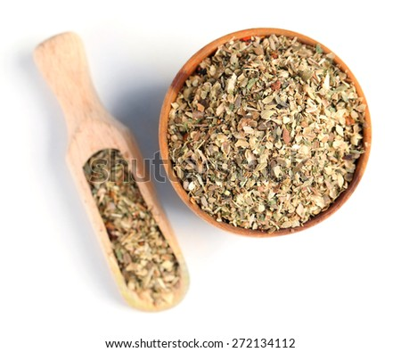 Dried parsley in wooden bowl, isolated on white - stock photo