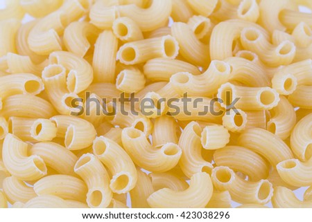 Dried Pasta Or Elbow Macaroni Over White Background