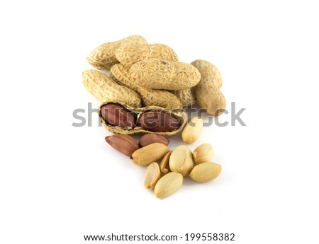 Dried peanuts in closeup on a white background