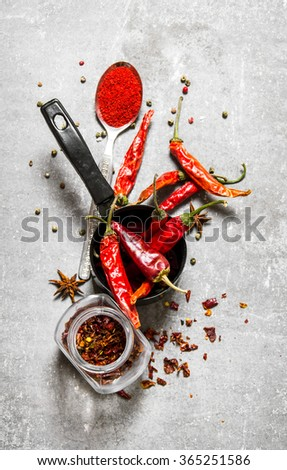 Dried peppers in a jar. On a stone background. Top view - stock photo
