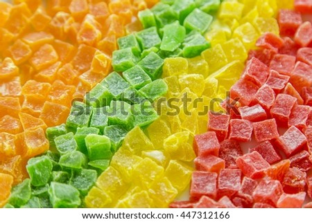 Dried pineapple, candied fruits in a row, four colors - stock photo