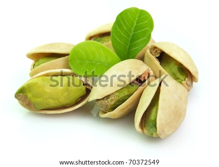 Dried pistachio with leaves - stock photo
