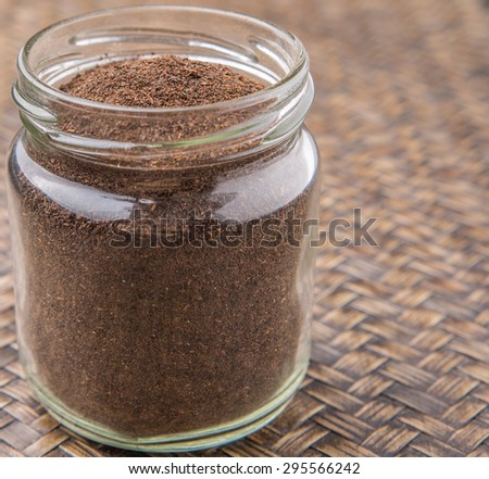 Dried Processed Tea Leaves In A Mason Jar Over Rustic Wicker Background