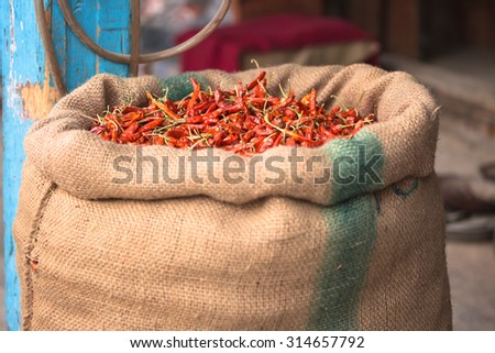 Dried red chili in sack - stock photo