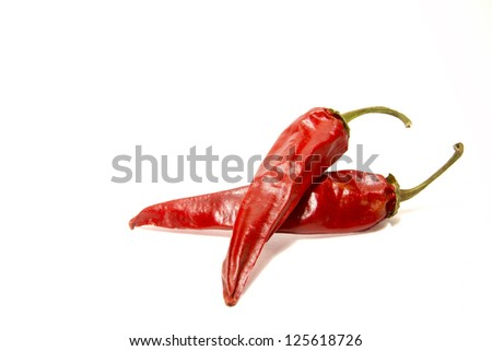 Dried red hot peppers  isolated on white. - stock photo
