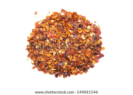 Dried red pepper flakes, isolated on white. - stock photo