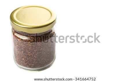Dried rooibos herbal tea leaves in mason jar over white background