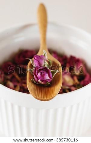 Dried rose petals: for tea, alternative medicine selective focus - stock photo