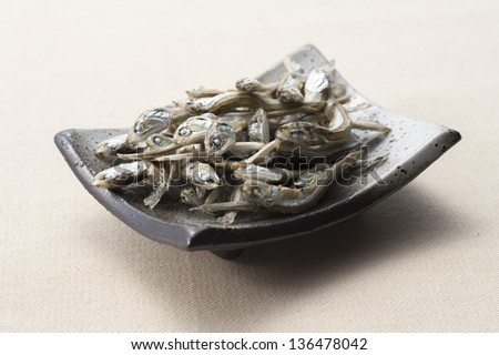 Dried sardine on a small dish