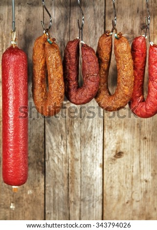dried sausage in the larder / wooden background / Still Life   - stock photo