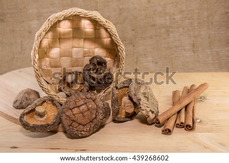Dried shiitake mushroom and Cinnamon sticks (Various spices) - stock photo