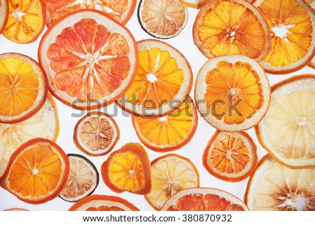 Dried slices of orange, grapefruit, lemon, lime and tangerine fruit - stock photo