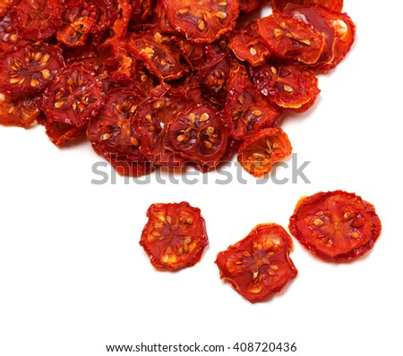 Dried slices of tomato. Isolated on white background. - stock photo