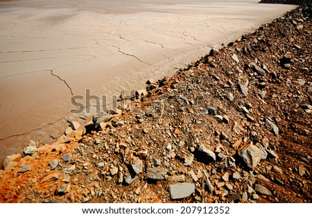 dried sludge in the settling tank to defend the technical water after iron ore beneficiation - stock photo