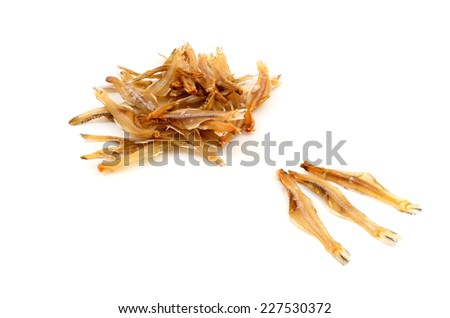 Dried Small fish in white background - stock photo