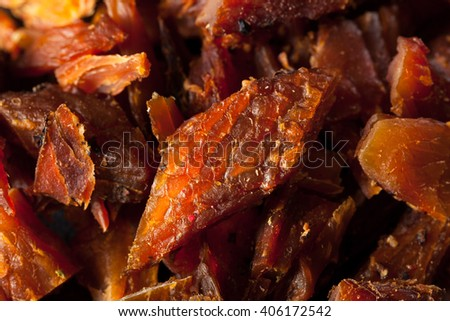 Dried Smoked Salmon Jerky with Salt and Pepper - stock photo