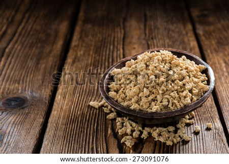 Dried Soy Meat (close-up shot) on wooden background - stock photo