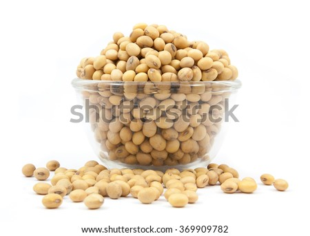 Dried soybean on glass cup isolated on a white background - stock photo
