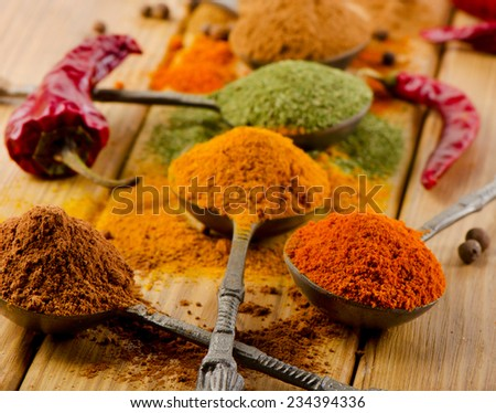 dried spices  and chilli peppers. Close up view - stock photo