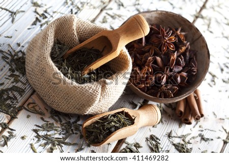 Dried tea leaves in jute bag and anise - stock photo