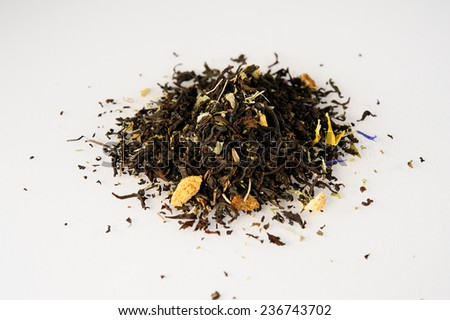 dried tea leaves with aromatic additives - stock photo
