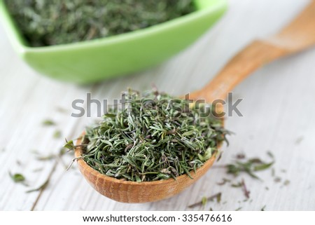 dried thyme on wooden surface