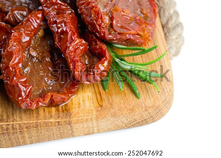 dried tomatoes on cutting board - stock photo