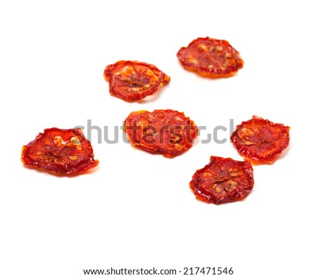 Dried tomatoes on white background. Selective focus - stock photo