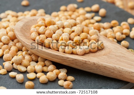 Dried yellow peas on a counter top.