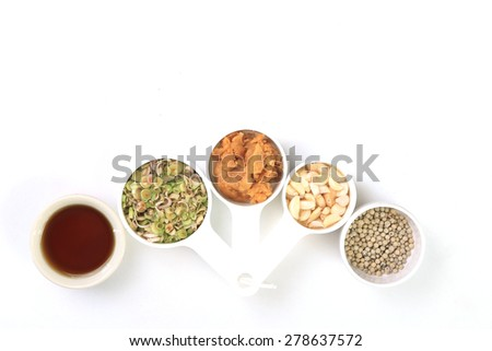 Dries chili, pepper,lemongrass,garlic,Coconut sugar and fish sauce, Thai herbs on white background. - stock photo
