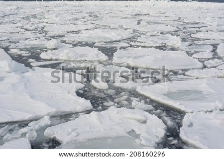 Drift ice in Abashini, Japan which has broken away from the shore or glaciers in small floes which can be driven into a dense mass by the wind to form pack ice , as viewed from the Aurora icebreaker - stock photo