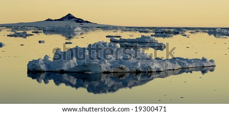 Drifting ice floe at dawn - stock photo