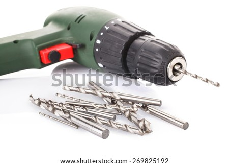 Drill and screwdriver set on white  background - stock photo