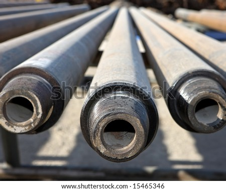 Drill pipe that is used to drill a well - stock photo