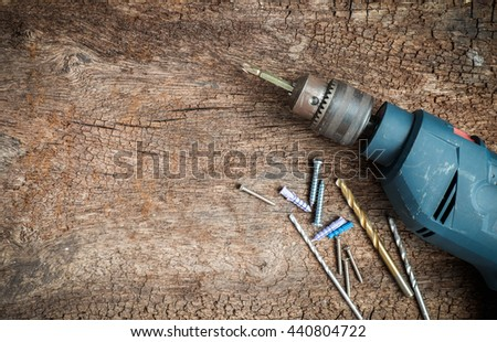 drill tool on dirty wood background