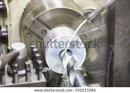 drilling and turning mold part by turning and lathe machine - stock photo